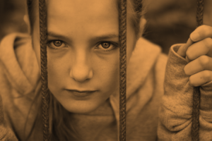 Sad orphan girl - sepia